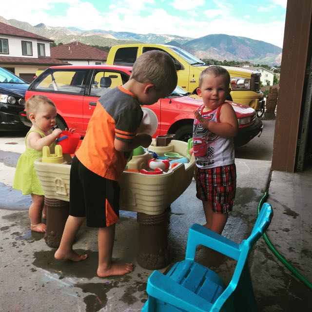 Playing with cousins Zeke and Levi at the water table was a daily occurrence!