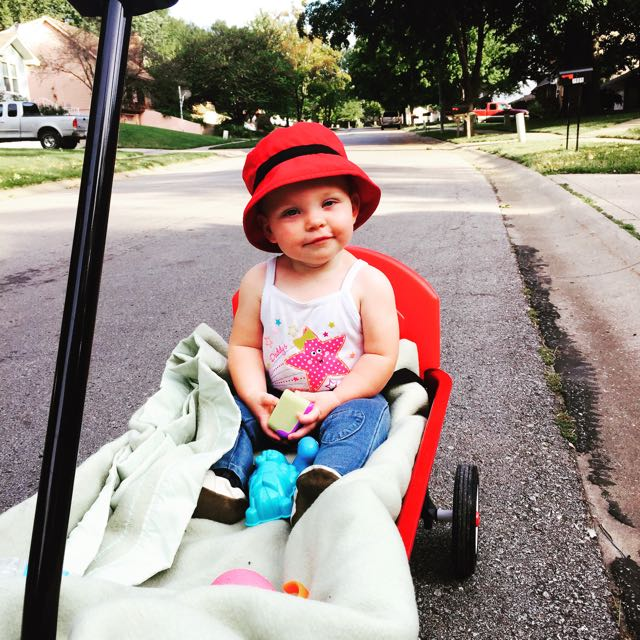 I love to take walks with Mommy in my wagon!