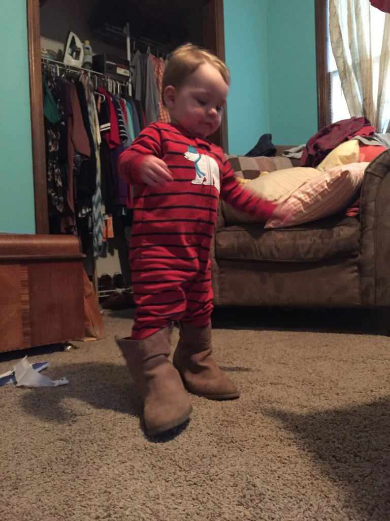 Trying on Mommy's boots ;)